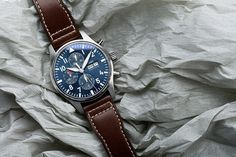 "The hallmark of the special editions marking the tale of ""The Little Prince"", the midnight blue dial gives this chronograph an unusual sense of depth. Iwc Watches, Watches For Men, Iwc Pilot Chronograph, 50th Birthday Presents, Dream Watches, Watch This Space, The Little Prince, Blue Plates, Midnight Blue"