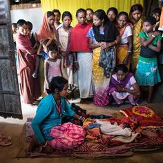 Resonate Bhumi sits over her severely deformed infant hours after giving birth at home in the village of Holing Kata in the Tinkharia plantation in Assam India. Bhumi's son was born with no arms and a cleft palate. Bhumi is one of many women working in the states tea plantations where anemia as well as malnutrition are endemic. Already weak and with few public-health resources to draw on too many of these women die from complications during pregnancy or childbirth.  Photograph by…