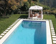 pool, easy cabana but I really like the square tiles laid around the pool instead of a big concrete pad
