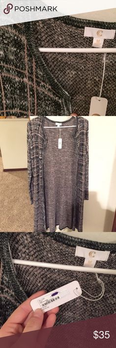 Brand New Longline Sweater Gorgeous black and white longline cardigan sweater with soft pink lines throughout! Very soft and a perfect wardrobe staple for fall! ❣️ Extremely small snag on the sleeve shown in picture, but never worn! Brand new with tags!!! 💟 Charming Charlie Sweaters Cardigans