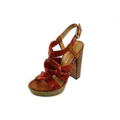 LUXURY REBEL Jen Orange Leather UXURY REBEL NEW Jen Orange Leather Platform Heels Sandals 7.5 Medium (B,M). Manufacturer: Luxury Rebel Size: 7.5 Medium (B,M) Size Origin: US Manufacturer Color: Rust Retail: $150.00 Condition: New without box Style Type: Heels Collection: Luxury Rebel Shoe Width: Medium (B, M) Heel Height: 5 1/4 Inches Platform Height: 1 1/4 Inches Closure: Buckle Material: Leather & Synthetic Upper/Man Made Sole Fabric Type: Leather Specialty: Knot-Front Luxury Rebel Shoes