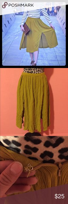 """TopShop High Waist Midi Double Split Green Skirt 2 Contemporary front slits update a flowy midi-length skirt composed with a finely shirred waistline for rippling movement. 29 1/2"""" length (size 8). Viscose rayon; machine wash. By Topshop; imported.  Pre-owned and gently used skirt has no flaws (no holes, stains, or smells). Hook and eye are coming unsewn but it can be sewn back in place.   CHECK OUT MY OTHER LISTINGS FOR MORE GREAT DEALS!!! FEEL FREE TO ASK QUESTIONS!!! Topshop Skirts"""
