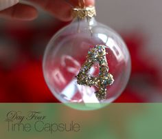 time capsule ornament for the kids.  to remember their favorite things at the age of ____.  awesome.