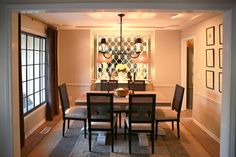 """The dining room was a total bonus,"" says Nate, who notes that the room previously had been used as a playroom for the boys. ""I found a salvage iron gate and placed it over the mirror, and we painted the window frames black. The curtains are from Restoration Hardware, and the accessories are all vintage."" LG Studio  - ELLEDecor.com"