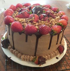 Chocolate cake with chocolate buttercream, ganache and strawberries I made :)