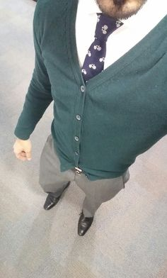 Grey suit, green mohair jumper, white twill shirt, bicycle tie