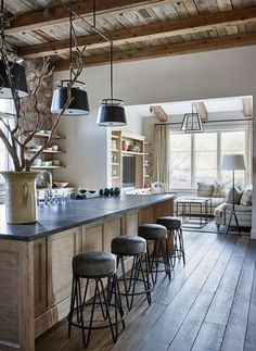 Love the ceiling and the beams. I would just put hanging lanterns instead of those lights. And instead of a TV in that room, I would put in a fireplace and make it a hearth room.