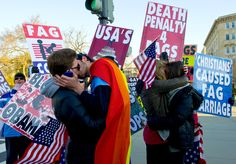 Gay Couples Rub PDA In Westboro's Face...(unfortunately under a story with some loathsome politician's bigoted, ignorant and highly offensive comments.