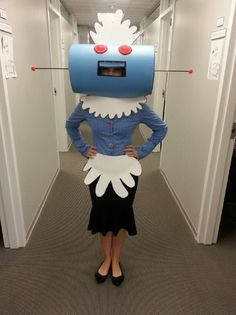 I was Rosie the Robot from the Jetson's for Halloween this year. Just two round pieces of styrofoam, two light blue posters, a couple dowel rods, felt, foam (for apron,cap,), and a sharpie. The buttons were pompoms hot glued to bobby pins and tucked into the button holes of my shirt. =22bucks and got great feedback