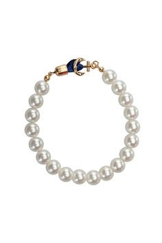 Dress up any outfit with the Anchor Pearl Bracelet! It makes any outfit stay fun and classy! No need to break the bank to get that fun and classy look you're searching for! An 8'' inner circumference with a gold anchor and ribbon closure.   Pearl Anchor Bracelet by Top It Off. Accessories - Jewelry - Bracelets Kentucky