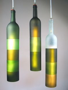 These lamps are made of glass wine bottles that have been cut, polished, frosted, and reassembled.