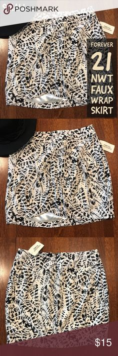 """💃 NWT Forever 21 Faux Wrap Skirt Small S I love the soft, rich lining and faux wrap design of this F21 mini skirt. It is brand new and ready to join your own closet. You have just found the perfect fall tee! I love the cute fall design and bling that makes this top pop.   Measurements  🍇 Waist, lying flat: 14 1/2"""" 🍇 Length (back): 16 1/2""""  From a smoke-free and happy-to-bundle closet.  No trades or transactions outside of Poshmark. [T2298] Forever 21 Skirts Mini"""