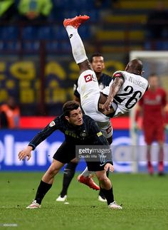Mateo Kovacic of FC Internazionale (L) and Gaby Mudingayi of AC Cesena compete for the ball during the Serie A match between FC Internazionale Milano and AC Cesena at Stadio Giuseppe Meazza on March 15, 2015 in Milan, Italy.