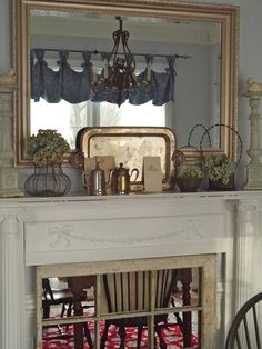 """Mirror """"window"""" as fireplace screen.  Chateau Chic: Keeping Out The Silver"""