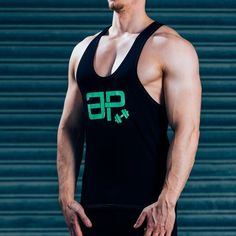 FormFit Vest - Black & GreenSHIPPING: PROCESSING TIME 3 - 4 Days ESTIMATED DELIVERY TIME 3 - 4 days for Domestic 4 - 6 days for International Superior quality cotton vest, simple design, tapered fit to showcase your physique. Designed with quality in mind, the same great feel after multiple washes, good as new for years to come. Styled for all day wear: complete with green printed logos & contrast stitching. #Musclesnotincluded 95% cotton, 5% Elastane Model is 5'11'' and wears an M Vest…