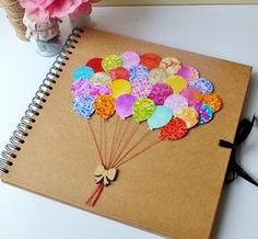 Beautifully hand-decorated scrapbook album - makes a perfect baby album / scrapbooking, photo album and even wedding comments book. The cover is so colourful, displaying 28 beautiful bright balloons, real cotton thread and a gorgeous wooden bow. This lov