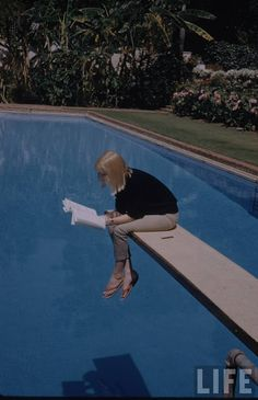 Actress May Britt reading over pool Photographer: Leonard McCombe. May Britt Wilkens, as she was known originally, was discovered as a teenager by Italian filmmakers, Carlo Ponti and. People Reading, Woman Reading, Reading Art, Reading Time, Reading Nook, Photographie Portrait Inspiration, Swedish Actresses, Diving Board, Tomboy Fashion