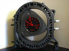 rotor clock made from a rotary engine Car Part Furniture, Automotive Furniture, Automotive Decor, Automotive Design, Motor Wankel, Wankel Engine, Car Part Art, Motorbike Parts, Motor Diesel