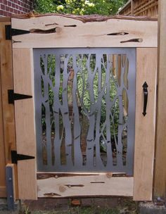 light wood gates with wrought iron decor - Google Search