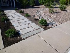Concrete paver walkway with cobble stone next to custom stream bed