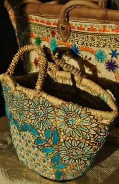 Beyond Marrakech: A Moroccan Basket  I love the embroidery on this basket.  Something is really rubbing me the wrong way about the description suggesting to store your extra bathroom soaps in it.  Seems very out of context.
