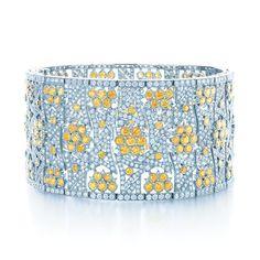 Tiffany Yellow Diamonds inspire a bracelet as radiant as sun-dappled flowers. 2013 Tiffany Blue Book.