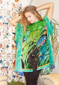 I wanted to create a mysterious, powerful moment, when a gorgeous black panther is slowly emerging from a forest. The intense green exotic plants, purple shades, black, shiny feline fur, and playful, bright parrots on the sleeves are hand painted with silk dye. ********************************************************************  This blouse is big and and drapes beautifully on any body type. It fits most sizes (M-XL) My cute model is size 6-8, so, as you can see, this tunic looks like a…