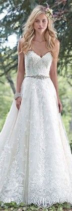 Dreamy lace and tulle combine to create this elegant ball gown wedding dress