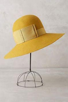 yellow fallish hat