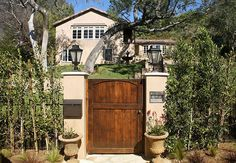 "Jeff Lewis ""Valley Oak 1"" entrance to sidewalk.  Driveway has matching large electronic door.  Fence is aluminum made to look iron or steel & black so is mostly see-through"