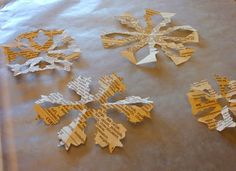 I make paper snowflakes every year to decorate at Christmas time, but this is a nice way to jazz it up - book page snowflakes!