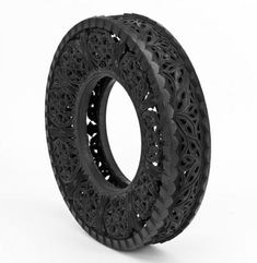 Carved tires by Wim DeIvoye via Design Milk  Don't know what you'd do with one... garden maybe?