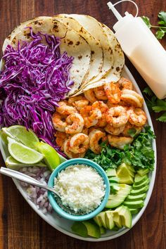 Shrimp Tacos are loaded with shrimp, cabbage, avocado, cotija, cilantro and served over gluten free corn tortillas. The shrimp taco sauce will win you over! Shrimp Taco Sauce, Shrimp Taco Recipes, Fish Recipes, Mexican Food Recipes, Dinner Recipes, Dinner Ideas, Shrimp Fajitas, Mexican Cooking, Meal Ideas