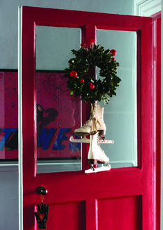 Door with a festive wreath painted in Rectory Red by Farrow & Ball