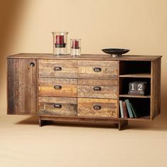 """Inspired combo of rustic charm with clean, contemporary design, handcrafted in a mix of FSC-certified reclaimed woods with a time-worn patina. Spacious storage via six drawers, fixed open shelves and adjustable shelves behind the cabinet door. Imported. Ships directly from our supplier in 2 to 4 weeks. Additional shipping, $400. 74""""W x 22""""D x 35""""H."""