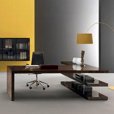 The great elegance of the ebony glossy finish is enhanced by the absolute purity of the extraclear glass that provides desk or bookcase a net sense of..