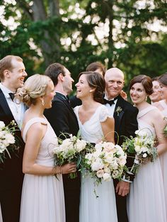 Bridesmaids with bouquets / Elegant Garden Wedding with Muted Tones