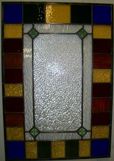 Custom window designed and constructed at Stained Glass Express in Waterville, Maine. Measures approximately 2 ft x 3 ft. Artist: Lucie Boucher