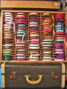 Used Audio Cassette Tape Case Storage Organizer Wall Rack becomes a Holder for Ribbon Rolls.