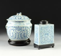 "TWO VINTAGE CHINESE BLUE AND WHITE PORCELAIN WARES, EARLY 20TH CENTURY, comprising a tapering circular jar with domed lid, height: 7 3/4"", diameter: 7""; a rectangular canister and a circular hardwood lid, raised on a conforming hardwood stand with splayed block feet, height: 5 1/2"", width: 4 3/8"", depth: 2 3/8""."
