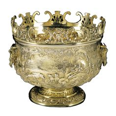 A George III silver-gilt monteith, maker's mark WB, London, 1818 elaborately repoussé with a huntsman, stag and hounds, flower garlands, winged figures, etc., drop handles above bearded satyr masks, detachable rim, associated domed cover with fruit, flower and scroll decoration, Thomas Gairdner, London, 1820
