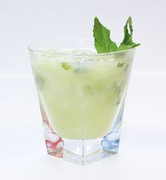 Honeydew Ginger Mojito 1 1/2 oz. Blue Chair Bay White Rum 3/4 oz. Ginger Simple Syrup 1/2 oz. Lime Juice 1/2 cup Honeydew Puree 5 Mint Leaves Top with club soda Garnish with sprig of mint