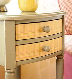 Decorate drawer fronts with scrapbook paper and change with different seasons or holidays