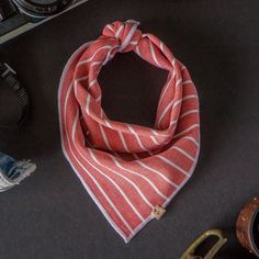 TOMMY. Our Rare Collection medium weight dog scarf in a stretch washed red and ivory stripe with genuine leather Oh Tiny Heart label. This piece is sure to be a classic in your growing Oh Tiny Heart collection. We wish we could let you reach through your screens to feel this material because once you touch it you'll understand exactly what separates Oh Tiny Heart from the pack. Grab yours before it's gone forever. Available now exclusively on ohtinyheart.com