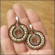 """Inspired by antique embroidery and beading techniques, Metro is a vintage-meets-modern approach to freeform bead sculpture. This pair of circle earrings we call """"Stella"""" are a hand-sculpted creation o"""