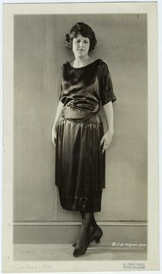 Woman In Black Dress With Tassels, Ca. 1921.] From New York Public Library Digital Collections.