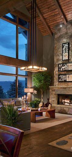 CSE Design. Love the lighting and artwork. Terrific vaulted living room.