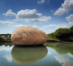 If It's Hip, It's Here: Floating Wooden Sustainable Egg Pod Is Home To Artist Stephen Turner For A Year.