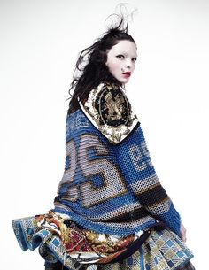 Mariacarla wears chainmail jersey by Nikhil Rode, commissioned by stylist's studio; embroidered print scarf (worn on shoulder) and embroidered print scarf  (worn as skirt) by stylist's studio; embroidered denim dress by Balmain; stud by Givenchy by Riccardo Tisci. Photography by Willy Vanderperre. Styling by Panos Yiapanis.