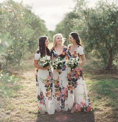 White dresses with pink, orange, purple, and blue flowers! Outright stunning. Choose these for a bohemian or garden wedding.